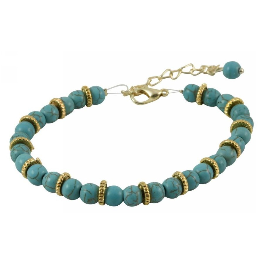Bracelet with metal elements and turquoise colored pearls